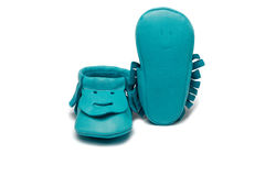 Childs turquoise booties on a white background Royalty Free Stock Photo