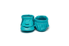 Childs turquoise booties on a white background Royalty Free Stock Images