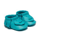 Childs turquoise booties on a white background Stock Photos