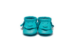 Childs turquoise booties on a white background Royalty Free Stock Photography