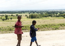 Childs walking in road Royalty Free Stock Images