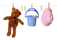Childs Washing Line. Washing line with childs holiday toys and teddy bear Stock Photography