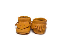 Childs yellow booties on a white background Royalty Free Stock Image