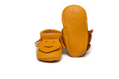 Childs yellow booties on a white background Royalty Free Stock Photography