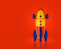 Childsstuk speelgoed raket op rode achtergrond Royalty-vrije Stock Foto's