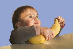 Childwith een banaan Stock Fotografie