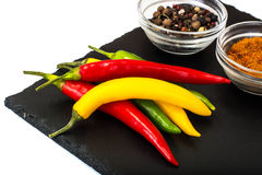 Chile on a black stone plate Stock Image