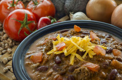 Chile con carne. Hot bowl of chile con carne in front of fresh ingredients royalty free stock images