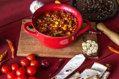 Chile con carne and ingredients for him. Mexican cuisine stock photo