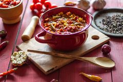 Chile con carne and ingredients for him. Mexican cuisine royalty free stock photos