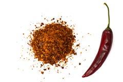 Chile, escamas de pimienta roja, granos y polvo de chile Imagenes de archivo