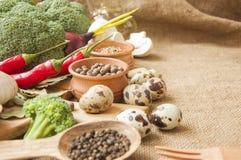 Chile, garlic, onions, broccoli, coriander, mushrooms, olive oil Stock Photo