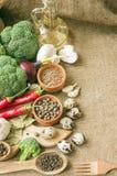 Chile, garlic, onions, broccoli, coriander, mushrooms, olive oil Royalty Free Stock Photo