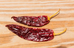 Chile Guajillo seco dried hot chili pepper. On wood background stock images
