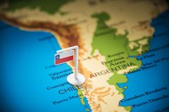 Chile marked with a flag on the map.  royalty free stock photo