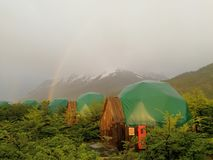 Chile Patagonia National Park Rainbow over Doom Base Camp. ! stock photos