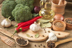 Chile pepper, garlic, onions, broccoli, coriander, cloves, olive Royalty Free Stock Photos