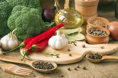 Chile pepper, garlic, onions, broccoli, coriander, cloves, olive Royalty Free Stock Photo