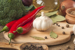 Chile pepper, garlic, onions, broccoli, coriander, cloves, olive Stock Photos