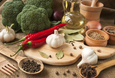 Chile pepper, garlic, onions, broccoli, coriander, cloves, olive Royalty Free Stock Image