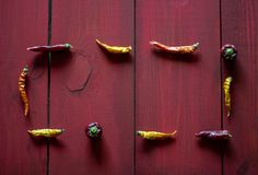 Chile Peppers on red wooden background. Top view stock image