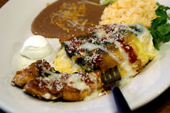 Chile Relleno Platter. Authentic, traditional Chile Relleno grilled, breaded, and filled with cheese.  Shown with refried beans and spanish rice Stock Photo
