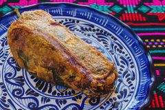 Chile relleno traditional Mexican cuisine in Mexico. Chile relleno, traditional Mexican cuisine in Mexico chile relleno comida mexicana stock photo