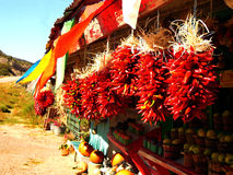 Chile Ristras in Autumn. A farm stand in rural northern New Mexico displaying traditional chile ristras in the autumn Stock Image