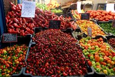 Chile`s pepper on the market in Hungary. Budapest peppers, tomatoes beans on the counter Bell pepper, sweet peppers, red, green, yellow Red hot Chilean pepper Royalty Free Stock Photo
