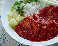Chileajo de cerdo. Dish originating from Oaxaca, Mexico.pork boiled in water and cooked in a thick sauce made of toasted guajillo chil Royalty Free Stock Photos