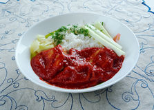 Chileajo de cerdo dish. Originating from Oaxaca, Mexico.pork boiled in water and cooked in a thick sauce made of toasted guajillo chil Royalty Free Stock Photo