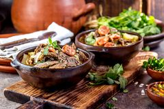 Chilean Ajiaco. Latin American food. Ajiaco - traditional chilean soup with grilled meat, onion and potato served in. Clay plates stock photos