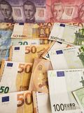 Chilean banknotes and euro bills. European, clp, peso, pesos, commerce, exchange, travel, trade, trading, value, buy, sell, profit, price, rate, cash, currency stock photo