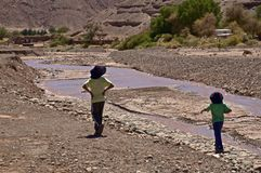 Chilean boys by river Royalty Free Stock Photo