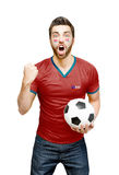 Chilean fan holding a soccer ball celebrates on white background Stock Image