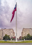 Chilean flag against clouds. Santiago, June 2013. Giant chilean flag on a big mast near the presidential palace in the main avenue of Santiago Stock Photo