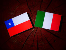Chilean flag with Italian flag on a tree stump isolated Stock Photography