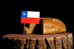 Chilean flag on a stump with bread Royalty Free Stock Photo
