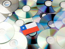 Chilean flag on top of CD and DVD pile isolated on white. Chilean flag on top of CD and DVD pile isolated Royalty Free Stock Photo