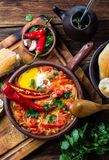 Chilean food. Picante caliente. Tomatoes, onion, chili fried with eggs Stock Photo