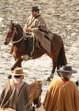 Chilean huasos in rodeo championship. Chilean huasos compete in rodeo championship Royalty Free Stock Photography