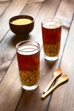 Chilean Mote con Huesillo. Traditional Chilean non-alcoholic cold drink called Mote (cooked husked wheat) con Huesillo (dried peach). The beverage is prepared by Royalty Free Stock Images