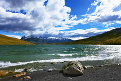 In the Chilean Patagonia gale. The fantastic lake Lagoon Azul in national park Torres del Paine. In the Chilean Patagonia gale Royalty Free Stock Images