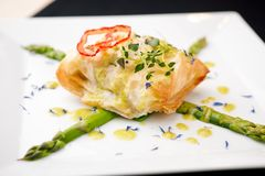 Chilean sea-bass. In papilliote on a plate royalty free stock images