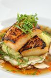 Chilean Sea Bass. On a enta Blanket with Fresh Mushrooms and Broth stock photo