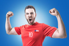 Chilean Soccer player on blue background Stock Images