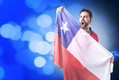 Chilean Soccer player on blue bokeh background royalty free stock photo