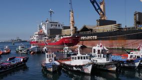 Valparaiso port freight and fishing ships. Chilean town Valparaiso port with shipping boats and a large freight stock footage