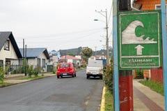 Chilean tsunami warning sign, Chile. Chilean tsunami warning sign in the town of Curaco de Velez in Quinchao Island, Chiloe Archipelago, Chile stock image