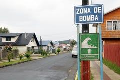 Chilean tsunami warning sign, Chile. Chilean tsunami warning sign in the town of Curaco de Velez in Quinchao Island, Chiloe Archipelago, Chile stock photography